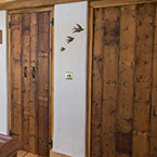 Reclaimed floorboard doors on landing